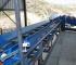 Linea automatizada para limpieza y transporte de troncos